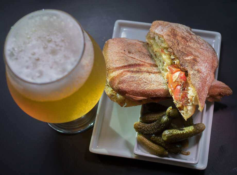 An Artichoke & Roasted Red Pepper Panini with a  Faction Brewing Belgian Ale at the Cadet wine bar in Napa, Calif., is seen on Saturday, August 9th, 2014. Photo: John Storey, Special To The Chronicle