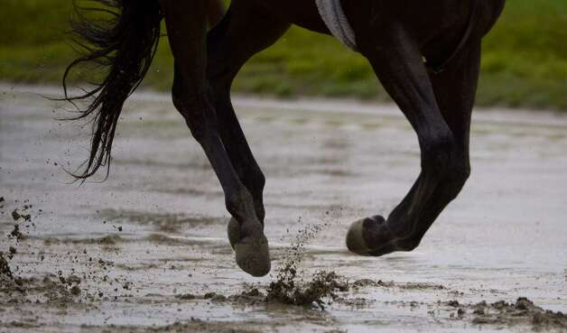 Heavy rains turned the main track at Saratoga Race Course into a sloppy mess on Thursday. (Skip Dickstein/Times Union)