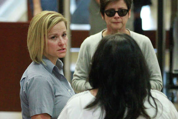 Dea Millerberg, left, arrives at 2nd District Court Thursday, Aug. 21, 2014, in Ogden, Utah. Millerberg, accused of helping her husband dump their teenage baby sitter's body in the woods after a night of sex and drugs, is scheduled to be sentenced Thursday. Millerberg agreed to a plea deal after testifying against her husband. She pleaded guilty in June to three felonies, including desecration of a human body. She faces up to five years in prison under the terms of the deal.