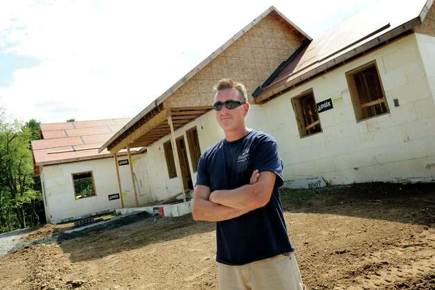 Andy Ellis, owner of Halfmoon Construction, stands by a net zero house he's building on Friday, Aug. 8, 2014, in Brunswick, N.Y.   (Cindy Schultz / Times Union) Photo: Cindy Schultz / 10028084A