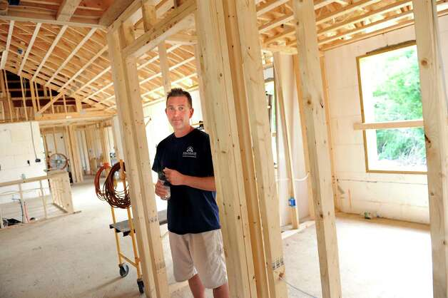 Andy Ellis, owner of Halfmoon Construction, inside a net zero house he's building on Friday, Aug. 8, 2014, in Brunswick, N.Y.   (Cindy Schultz / Times Union) Photo: Cindy Schultz / 10028084A
