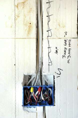An electrical outlet is fitted in a cut section of an insulated concrete form inside a net zero house on Friday, Aug. 8, 2014, in Brunswick, N.Y. (Cindy Schultz / Times Union) Photo: Cindy Schultz / 10028084A