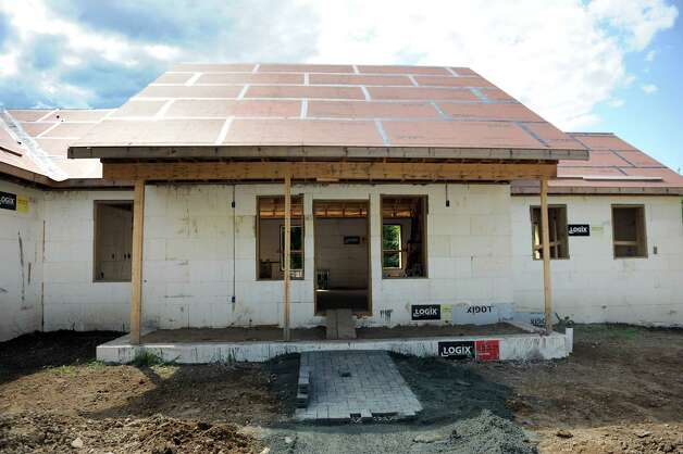 The front of a net zero house on Friday, Aug. 8, 2014, in Brunswick, N.Y. (Cindy Schultz / Times Union) Photo: Cindy Schultz / 10028084A