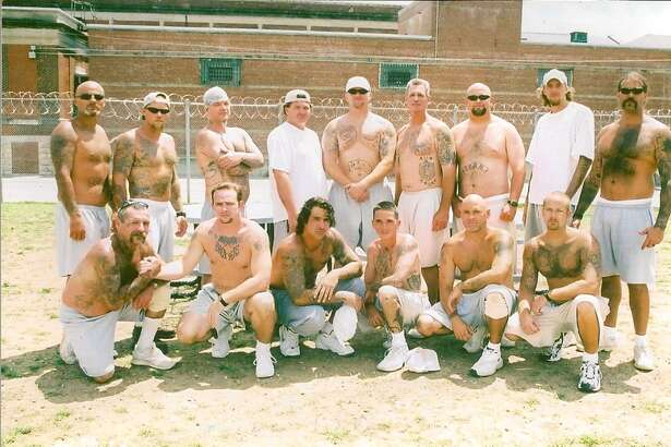 Authorities say this photo is of members of the Aryan Circle in federal prison. In Texas state prisons, members are automatically kept isolated from one another and the general prison population by serving time in one man cells where they are locked up 23 hours a day. This photo was taken in a federal prison, not a state prison.