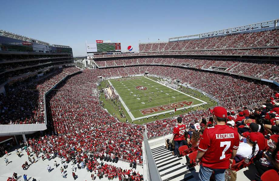 Fans at Levi's Stadium watch during an NFL preseason football game between the San Francisco 49ers and the Denver Broncos in Santa Clara, Calif., Sunday, Aug. 17, 2014. (AP Photo/Tony Avelar) Photo: Tony Avelar, Associated Press