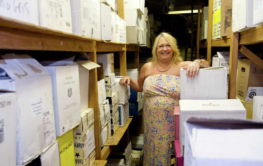 Horseneck Wines & Liquors owner Theresa Rogers poses for a photo in the 80-year-old store, which she has owned for 25 years, on Thursday, August 21, 2014. Photo: Lindsay Perry / Stamford Advocate