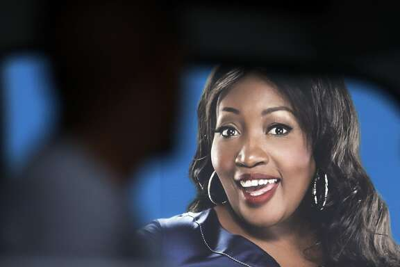 "A taxi with passengers drives past a billboard featuring Sophie Ndaba, an actor who played the Queen Moroka character in ""Generations,"" soap opera displayed on the street in Soweto, South Africa, Wednesday, Aug. 20, 2014.  ""Generations,"" a hugely popular soap opera in South Africa, first aired in 1993, a year before the nation's first all-race elections ended apartheid. Now the future of this television staple followed by millions is up in the air. (AP Photo/Themba Hadebe)"