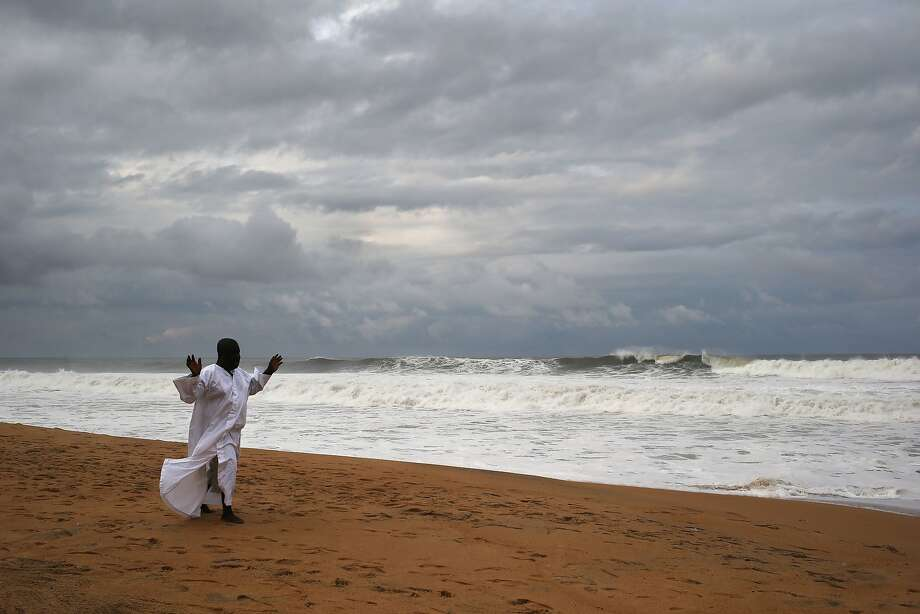 Deliver us from Ebola: On a beach in Monrovia, a member of the Church of Aladura prays to God to rescue Liberia from its Ebola crisis. The outbreak has killed more than 1,200 people in four African nations, with more in Liberia than any other country. Photo: John Moore, Getty Images
