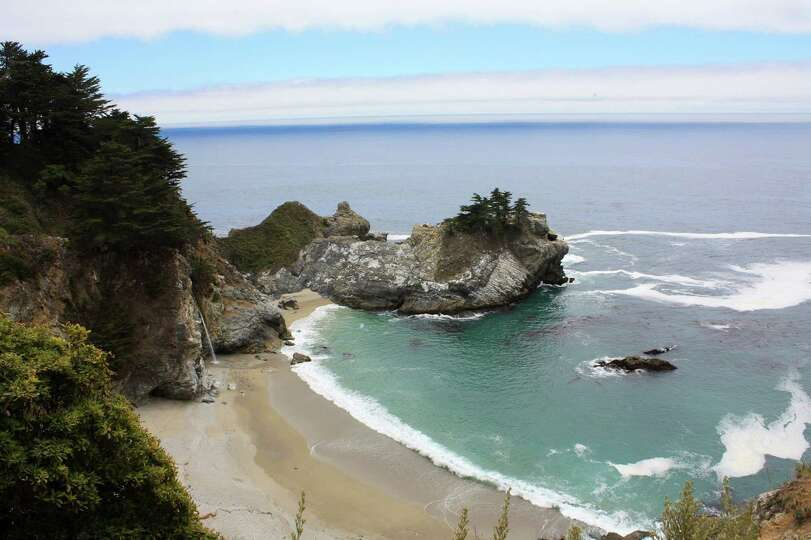 McWay Falls tumbles 80 feet to a sandy beach along the Pacific Ocean at Julia Pfeiffer Burns State P