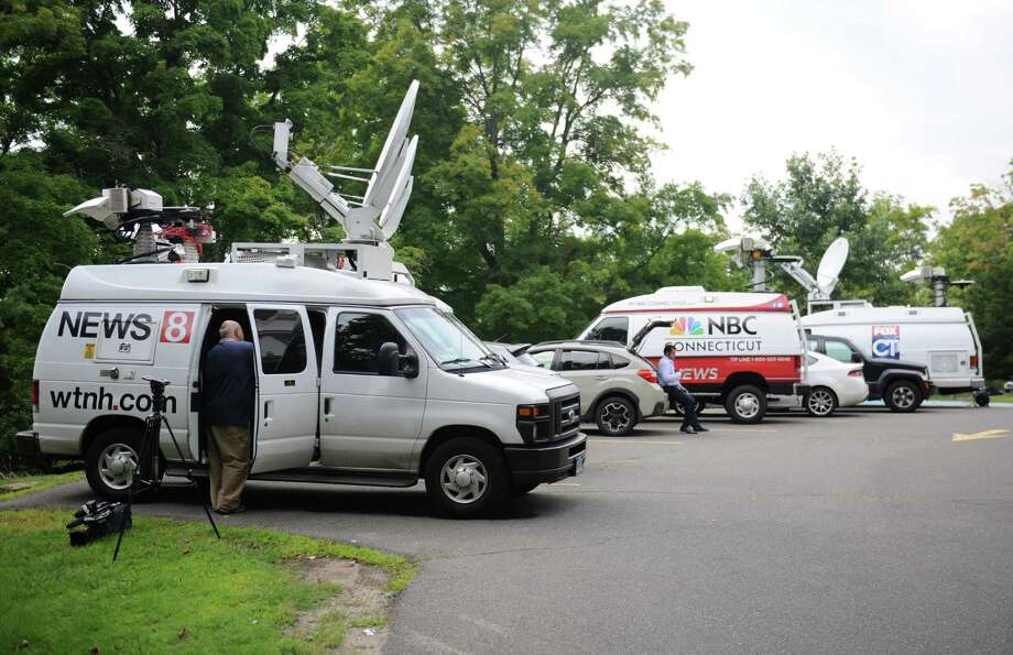 Media wait outside the Ridgefield Police Station in Ridgefield, Conn. Thursday, Aug. 21, 2014.  The medical examiner ruled the July 7 death of 15-month-old Benjamin Seitz a homicide.  Police said the child's father, Kyle Seitz, was supposed to drop the boy off at daycare, but instead left the child in his car in the parking lot of his workplace for an extended period of time. Photo: Tyler Sizemore / The News-Times