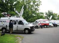Media wait outside the Ridgefield Police Station in Ridgefield, Conn. Thursday, Aug. 21, 2014.  The medical examiner ruled the July 7 death of 15-month-old Benjamin Seitz a homicide.  Police said the child's father, Kyle Seitz, was supposed to drop the boy off at daycare, but instead left the child in his car in the parking lot of his workplace for an extended period of time.