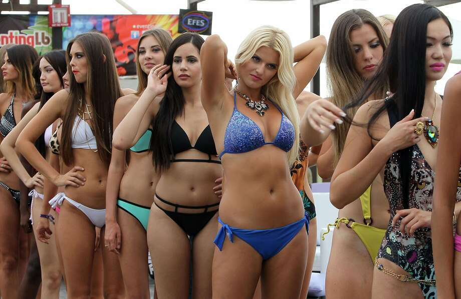 "The global search for a next top model continues: Models line up for the ""Miss Bikini"" event, part of ""World Next Top Model 2014,"" at the Publicity beach resort in the Lebanese coastal city of Byblos. Photo: Anwar Amro, AFP/Getty Images"