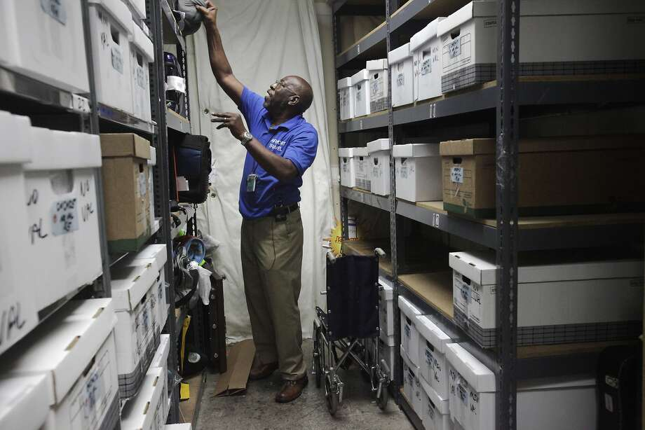 Linard Davis of the Airport Travel Agency shows where items left at security checkpoints end up in a room at SFO. Photo: Leah Millis, The Chronicle