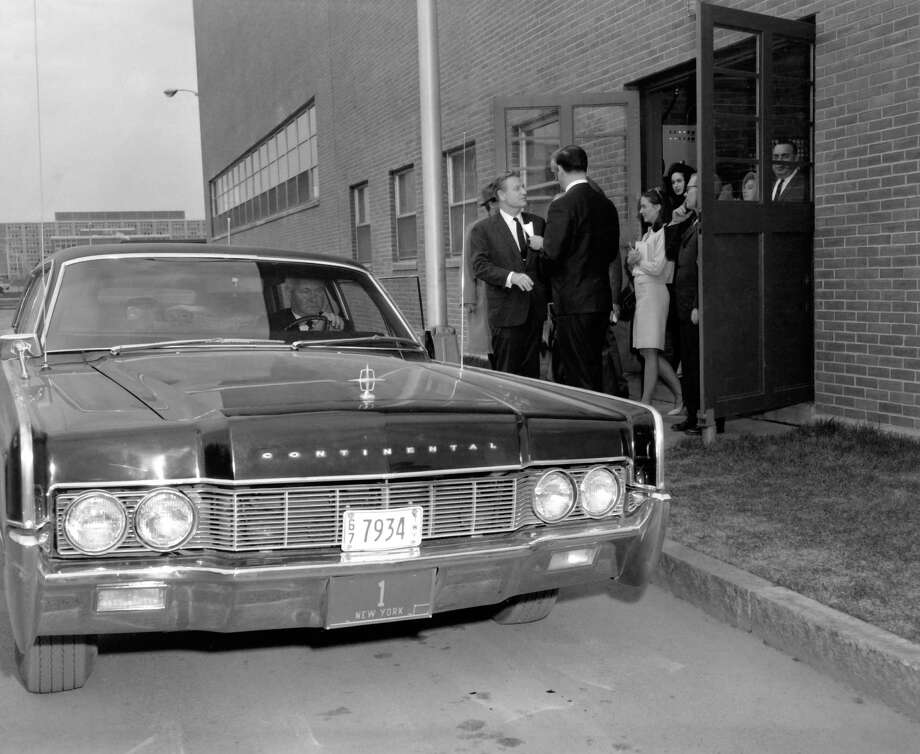 Gov. Nelson A. Rockefeller (facing camera) stands beside the Lincoln Continental Lehmann-Peterson limousine in 1967. (Courtesy of the New York State Archives)
