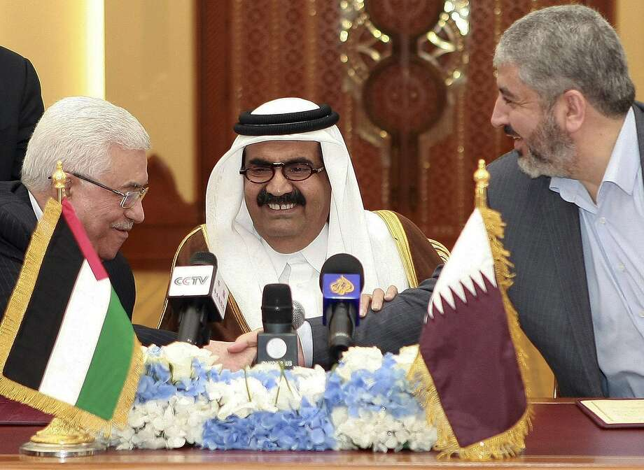 Palestinian leader Mahmoud Abbas, (left), the Emir of Qatar and Hamas' Khaled Mashaal meet in Doha. Photo: Osama Faisal, Associated Press