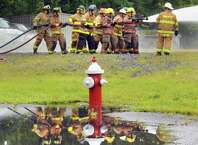 One hundred  Fire Department Explorers and Junior Firefighters from across New York State participate in hands-on firefighter exercises during the 6th Annual Future of the Fire Service Youth Day at the George H. Proper Jr. Municipal Emergency Services Training Center on Thursday, Aug. 21, 2014, in Colonie, N.Y. (Michael P. Farrell/Times Union)