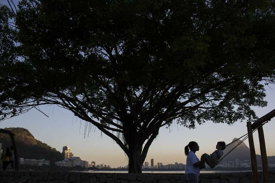 A nanny pushes a boy on a swing in Rio de Janeiro. A new law is the latest effort to extend the country's generous labor laws to domestic workers. Photo: Felipe Dana, Associated Press
