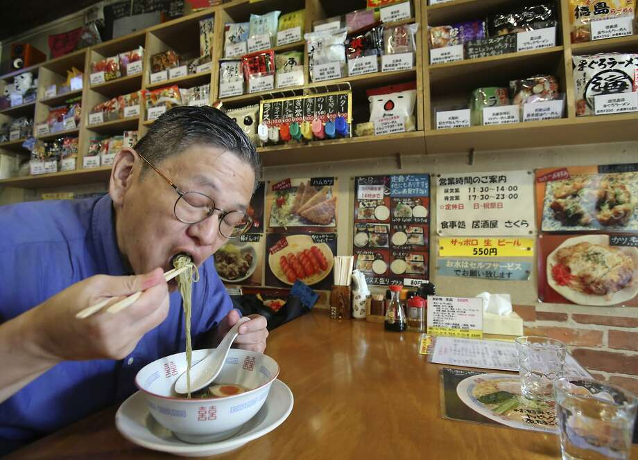 Masaya Sokusekisai Oyama slurps ramen at a restaurant that specializes in instant noodles in Tokyo. Photo: Koji Sasahara, Associated Press