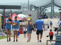 Fans, athletes and family members walk between the fields during the Nationals baseball tournament at Ford Park on Monday. Photo taken Monday, July 21. 2104 Guiseppe Barranco/@spotnewsshooter