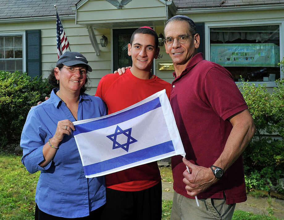 Penny and Stephen Block flank their son, Stanley, outside the Block family home in Stamford, Conn., on Tuesday, Aug. 19, 2014. Stanley Block recently returned home after serving with the Israel Defense Forces as a paratrooper tasked with finding tunnels during the conflict in Gaza. Photo: Jason Rearick / Stamford Advocate