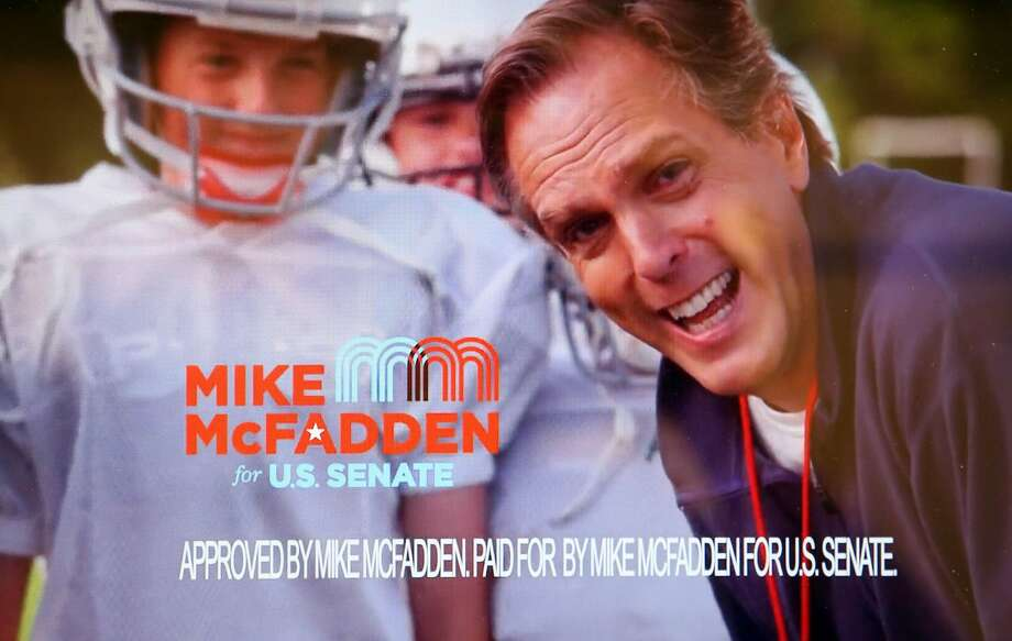 In one of his campaign's TV ads, Republican candidate for U.S. Senate Mike McFadden delivers the standard campaign disclosure in a high-pitched voice after taking a punch from a young football player. Photo: Associated Press