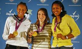 Minnesota Lynx basketball players from left, Seimone Augustus, Lindsay Whalen, and Maya Moore display their gold medals in women's basketball from the London Olympics during a news conference, Wednesday, Aug. 15, 2012, in Minneapolis. (AP Photo/The Star Tribune, Richard Tsong-Taatarii)  MANDATORY CREDIT; ST. PAUL PIONEER PRESS OUT; MAGS OUT; TWIN CITIES TV OUT