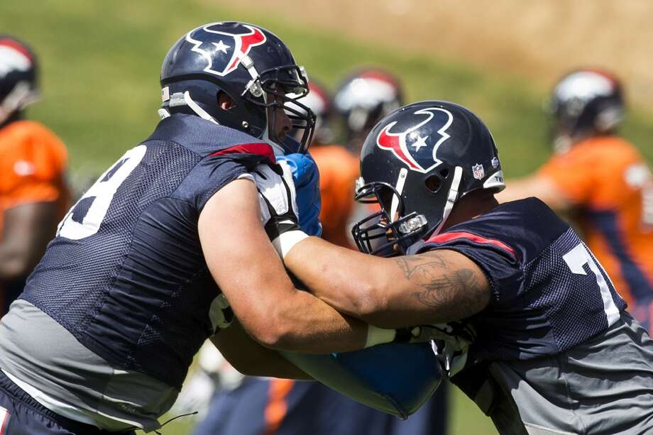 Day 18: August 21   Texans tackle Tyson Clabo (69) and guard Brandon Brooks (79) run through a blocking drill during a joint practice with the Denver Broncos on Thursday. Photo: Brett Coomer, Houston Chronicle