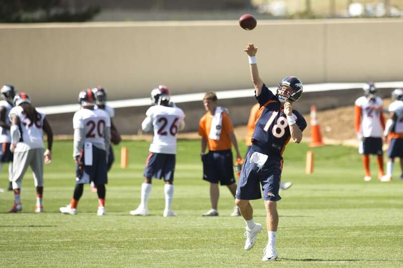 Broncos quarterback Peyton Manning throws a pass.