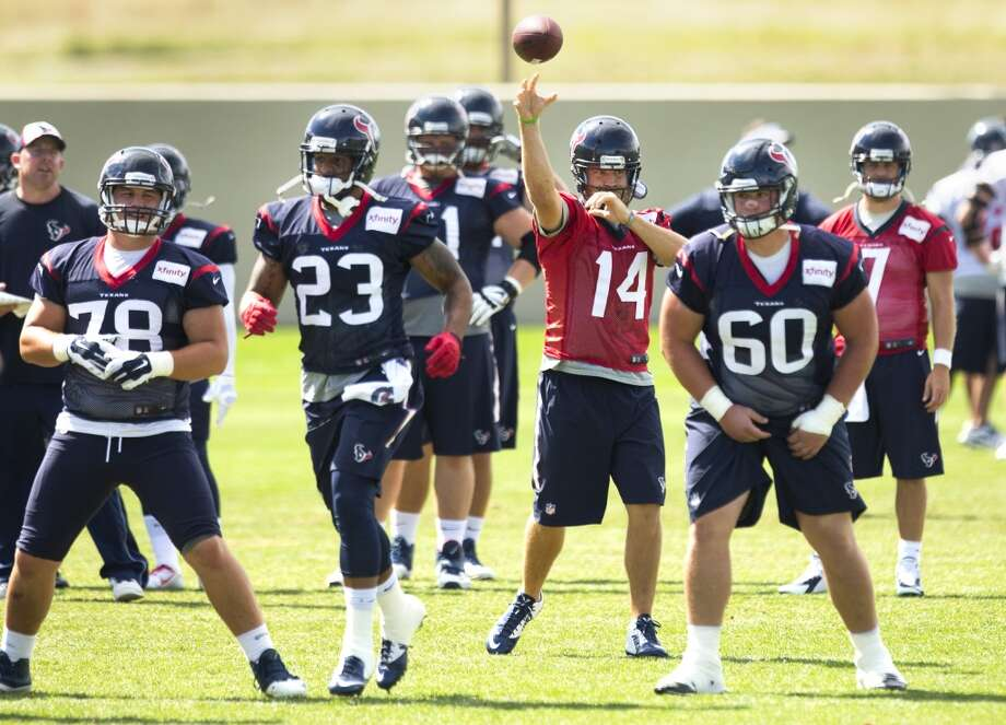 Texans quarterback Ryan Fitzpatrick (14) throws a pass over center James Ferentz (78), running back Arian Foster, and guard Ben Jones (60). Photo: Brett Coomer, Houston Chronicle