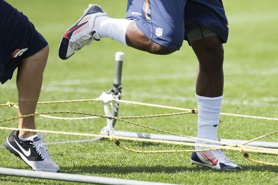 Broncos running backs run through a ropes drill. Photo: Brett Coomer, Houston Chronicle