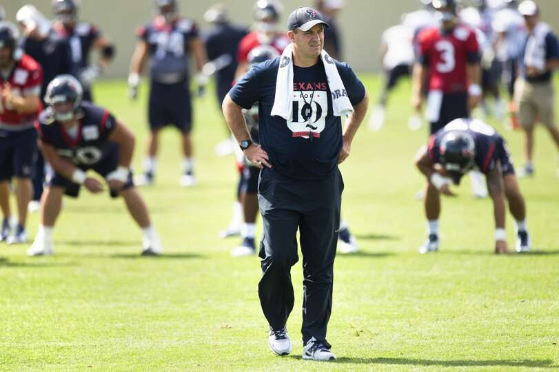 Texans head coach Bill O'Brien walks across the field.