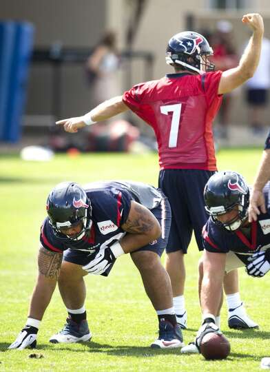 Texans quarterback Case Keenum (7) directs traffic.