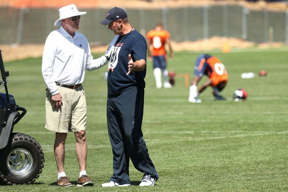 Texans owner Bob McNair, left, talks to head coach Bill O'Brien following a joint practice. Photo: Brett Coomer, Houston Chronicle