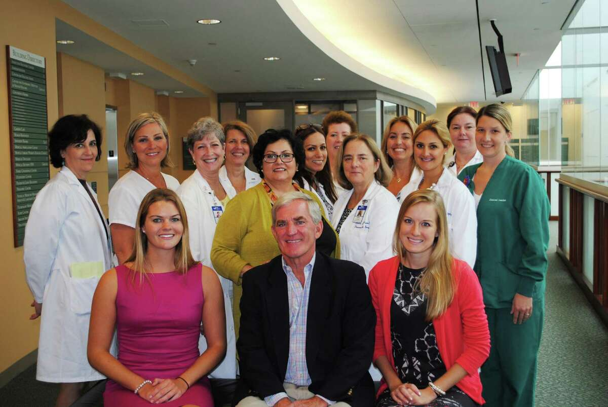 Members of Greenwich Hospital cancer care teams joined oncology fellowship program sponsor Fred C. Flynn, Jr. at a celebration for graduating fellows Kaitlin Campbell (seated, left) and Julia Melvin (seated, right) in July.
