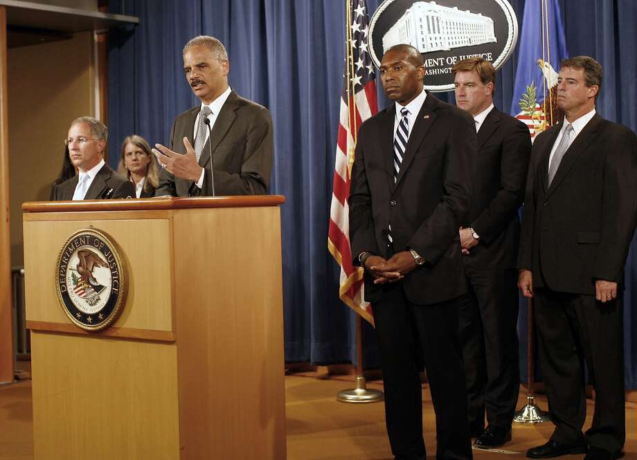 Attorney General Eric Holder is joined by state and federal officials as he announces settlement details. Photo: Lauren Victoria Burke, Associated Press