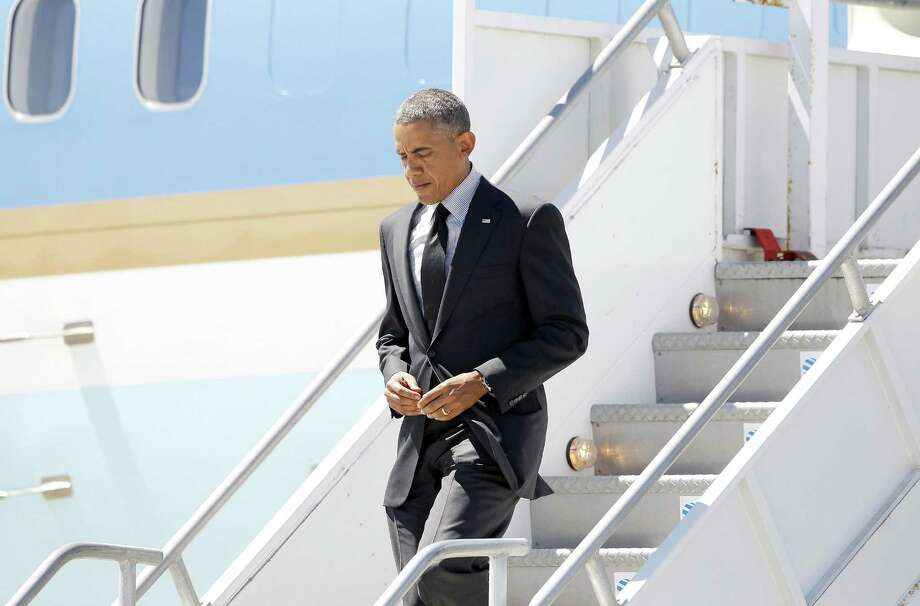 President Barack Obama's self-imposed isolation is damaging his job performance at a crucial time in his presidency. Photo: Associated Press / AP