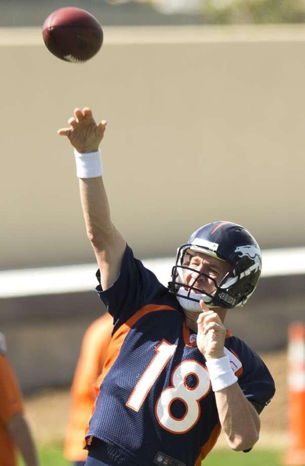 Broncos quarterback Peyton Manning throws a pass. Photo: Brett Coomer, Houston Chronicle