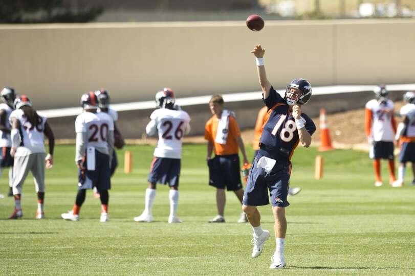 Broncos quarterback Peyton Manning throws a pass.