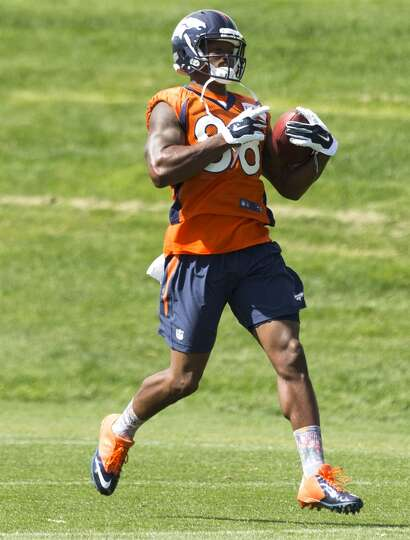 Broncos wide receiver Demaryius Thomas runs upfield after making a catch.