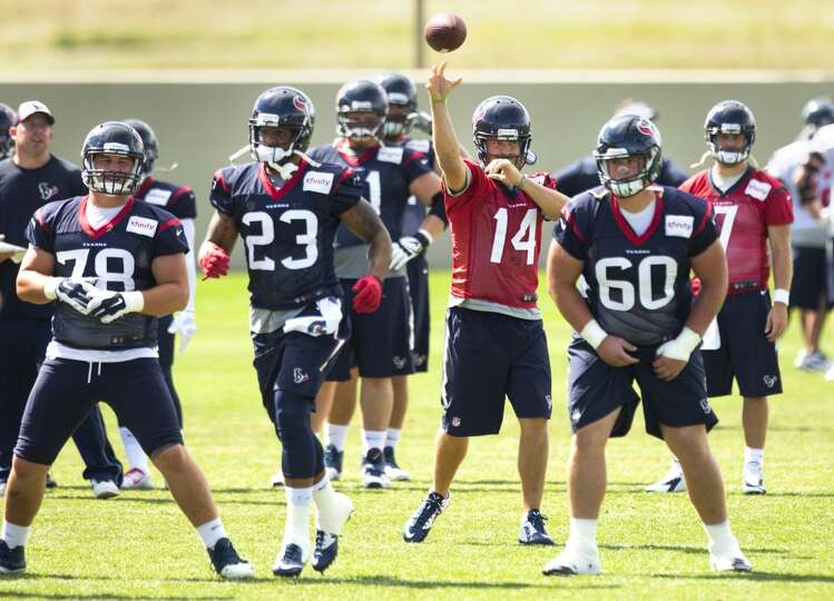 Texans quarterback Ryan Fitzpatrick (14) throws a pass over center James Ferentz (78), running back