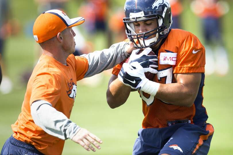 Broncos running back Jerodis Williams (33) runs through a drill.