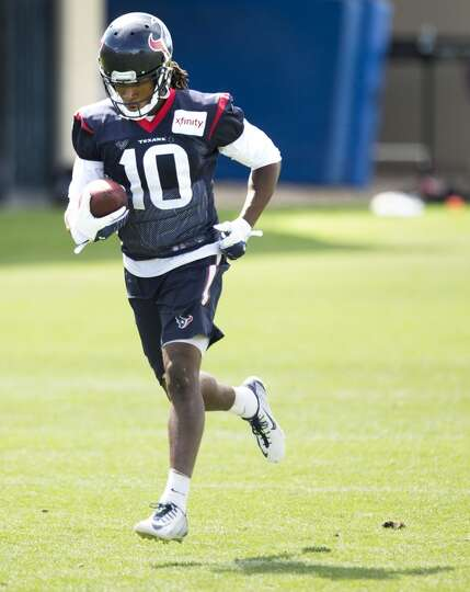 Texans wide receiver DeAndre Hopkins runs upfield after making a catch.