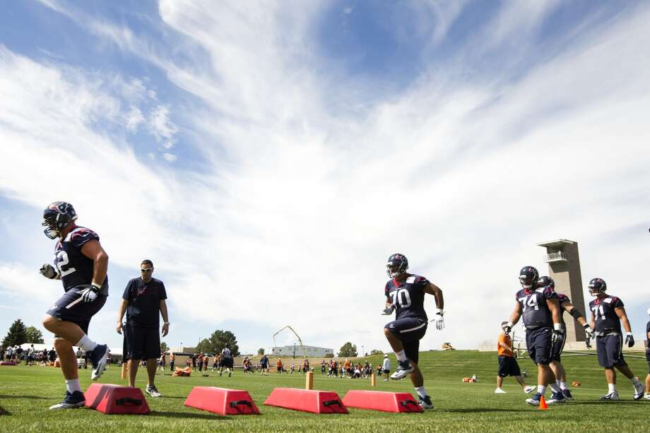Texans offensive linemen Alex Kupper (62), Xavier Su'a-Filo (70), Matt Feiler (74) and Mike Farrell (71) run a drill. Photo: Brett Coomer, Houston Chronicle