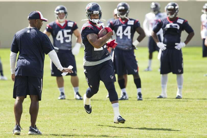 Texans running back Arian Foster (23) runs upfield after making a catch.