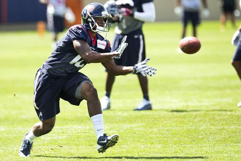 Texans wide receiver Lacoltan Bester reaches out to make a catch.