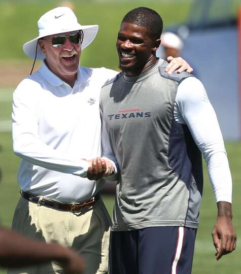 Texans owner Bob McNair, left, embraces wide receiver Andre Johnson (80) following a joint practice.