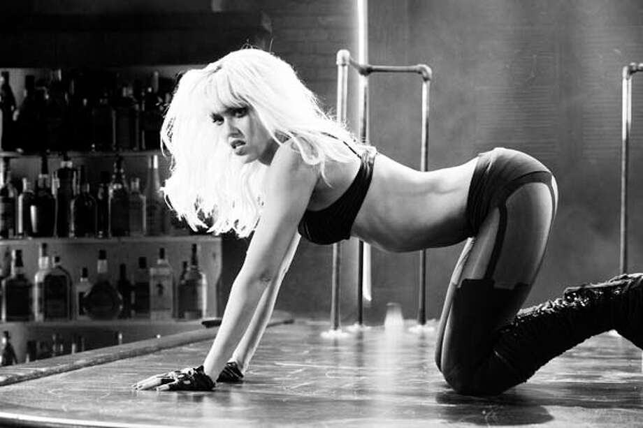 """""""Sin City: A Dame to Kill For"""" premieres Friday. Take a sneak peek at the film through these stills, then check out the scenes from """"Frank Miller's Sin City,"""" released in 2005.Jessica Alba as Nancy. Photo: Handout / The Weinstein Company"""