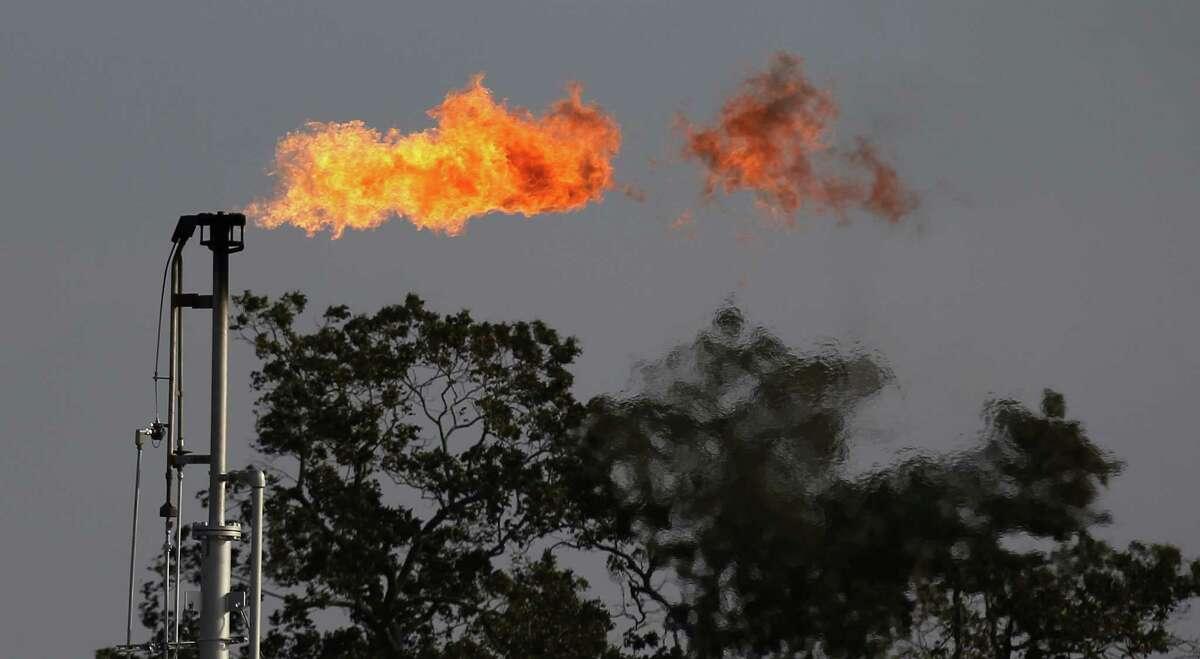 A flare burns off excess gas at a well near Nordheim, Texas.