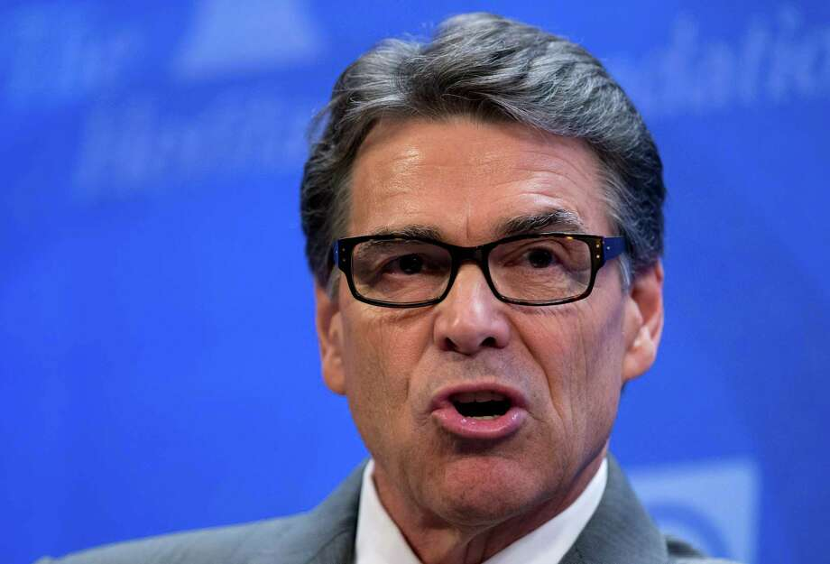 Gov. Rick Perry speaks at the Heritage Foundation in Washington on Thursday. Days after he surrendered to Texas authorities on felony abuse-of-power charges, Perry spoke at a forum on immigration. Photo: Manuel Balce Ceneta, AP / AP