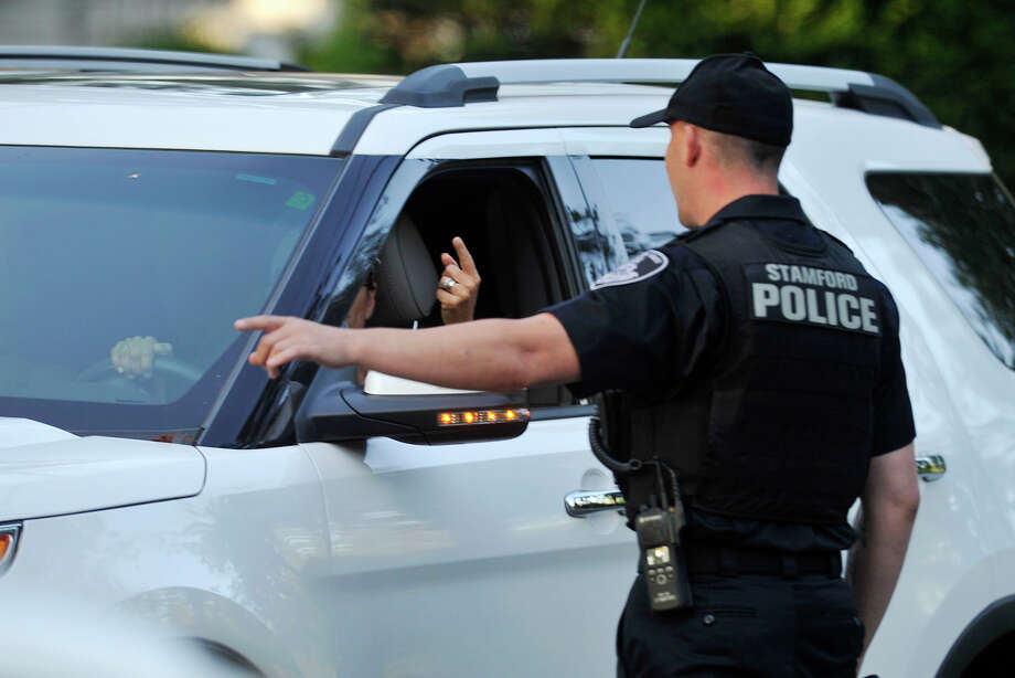Stamford police direct traffic around Vice President Joe Biden's fundraiser in the Shippan Point section of Stamford, Conn., on Wednesday, Aug. 20, 2014. Photo: Jason Rearick / Stamford Advocate